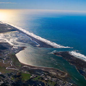 Ariel view of Humboldt Bay Eureka CA with white surf blue ocean