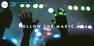 Follow The Magic: Reggae on the River-Silhouette of two hands and arms held up against red blue green stage lighting at night