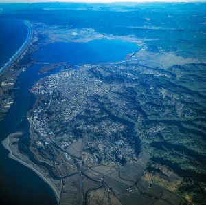 10,000 feet aerial view over Eureka CA showing city and blue Humboldt Bay