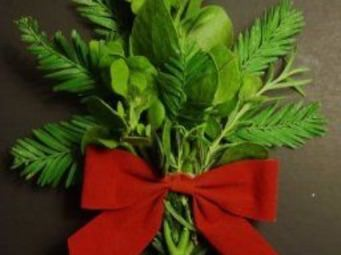 Holiday greenery wrapped with a red velvet bow.