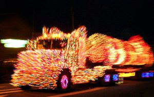 Big-rig completely covered with multi-color Christmas lights in truckers parade