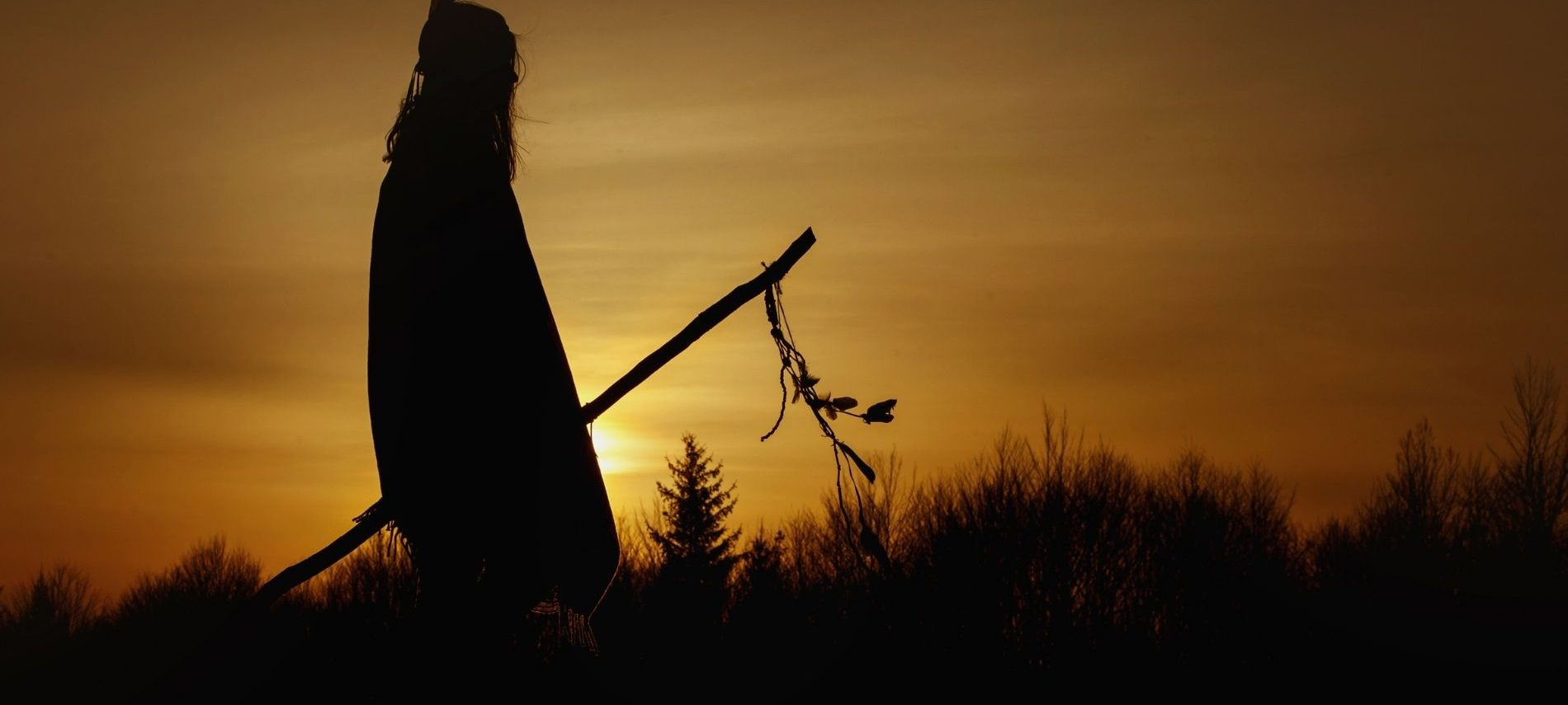 Silhouette at sunset of native american