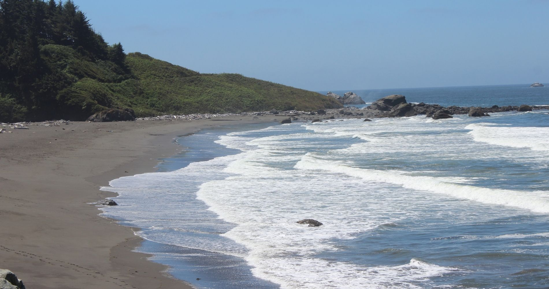 Sandy and rocky beach with winding shore along Redwood Coast CA