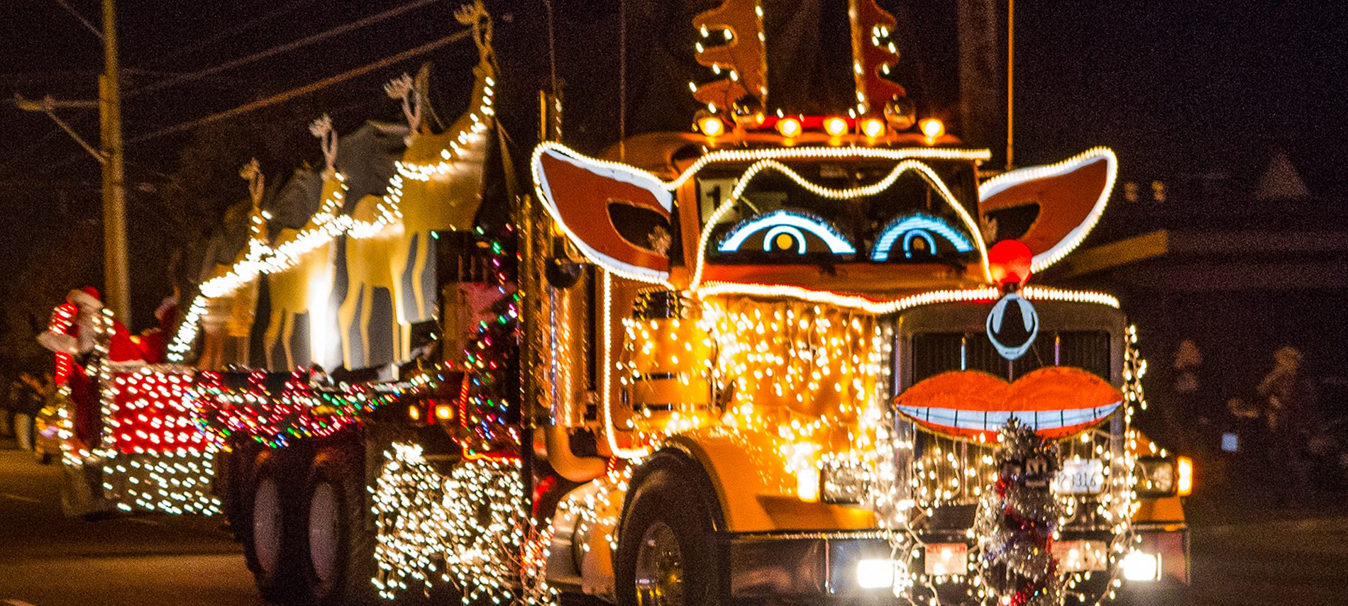 trucker parade truck lighted with multicolor Christmas lights Santa sleigh and reindeer