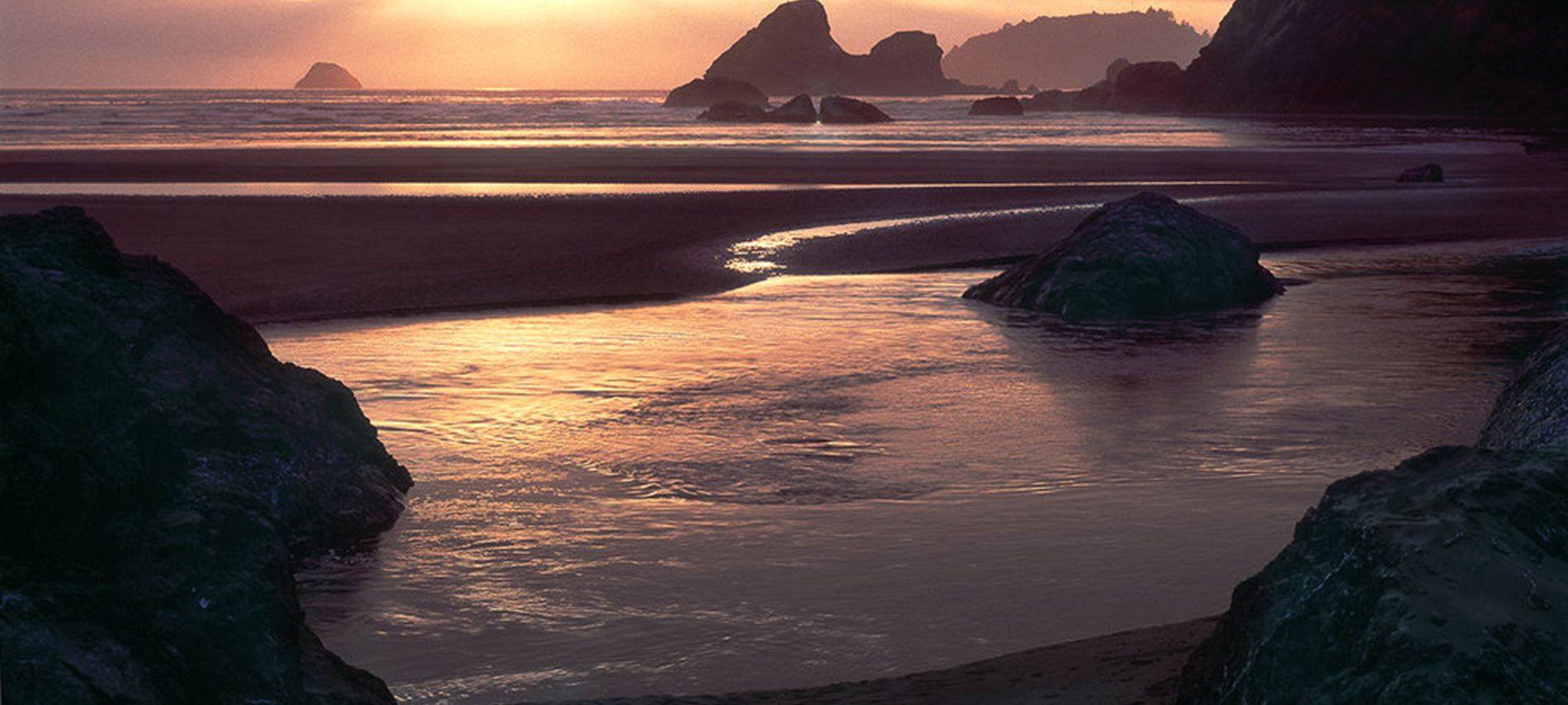 sunset with pink clouds and sea along rocky CA Redwood Coast